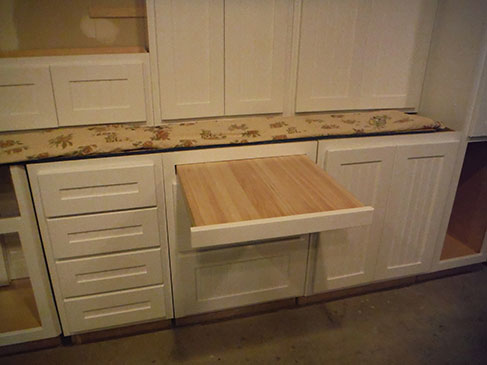 CUSTOM CABINETS WITH PULLOUT CUTTING BOARD